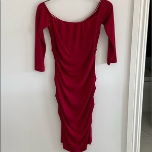 Red off the the shoulder dress by Nicole Miller.